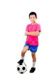 有足球的亚裔男孩 免版税库存照片