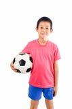 有足球的亚裔男孩 库存照片
