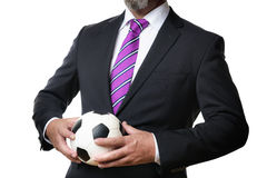 有足球的商人 免版税图库摄影