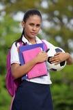 有足球的女性少年学生运动员 图库摄影