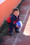 有足球的新男孩 免版税库存图片