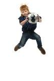 有足球的红头发人男孩 免版税库存照片
