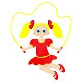 有跳绳的逗人喜爱的愉快的小女孩 库存照片