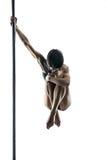 有身体艺术的女性杆舞蹈家在定向塔 图库摄影