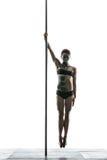 有身体艺术的女性杆舞蹈家在定向塔 免版税库存图片