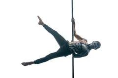 有身体艺术的男性杆舞蹈家在定向塔 库存图片