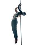 有身体艺术的男性杆舞蹈家在定向塔 免版税库存图片