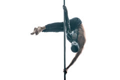 有身体艺术的男性杆舞蹈家在定向塔 图库摄影
