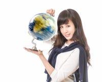 有转动的地球的亚裔妇女在手上 免版税库存图片