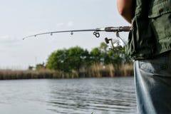 有转动的渔夫在河 库存图片