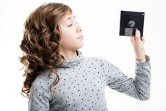 有软盘的女孩 免版税库存照片