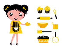 有辅助部件的逗人喜爱的烹调女孩 库存照片