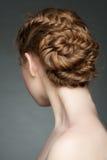 有辫子发型的妇女 免版税库存照片