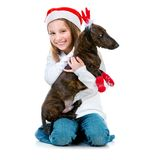 有达克斯猎犬的小逗人喜爱的女孩 库存照片