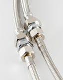 有连接器的有弹性金属纤维水管 库存照片