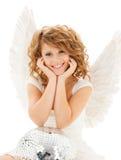 有迪斯科球的愉快的少年天使女孩 库存照片