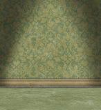 有退色的绿色锦缎墙纸的空的室 库存照片