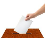 有选票和箱子的手 免版税图库摄影