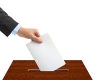 有选票和箱子的手 库存图片