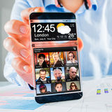 有透明屏幕的智能手机在人的手上。 库存图片