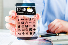 有透明屏幕的智能手机在人的手上 免版税库存图片