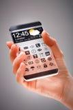 有透明屏幕的智能手机在人的手上 免版税库存照片