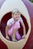 有逗人喜爱的乐趣的女孩 免版税库存照片