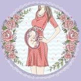 有逗人喜爱的婴孩的孕妇 免版税图库摄影