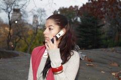 有通信设备的女孩 库存图片
