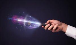 有遥控和光亮的数字的手 图库摄影