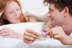 有避孕套的十几岁的男孩 库存图片
