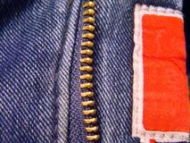 有邮编紧固件的蓝色牛仔裤 免版税库存照片