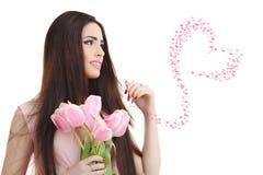 有郁金香花束的妇女 图库摄影