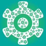 有里面许多小嵌齿轮的绿色嵌齿轮轮子 免版税库存图片