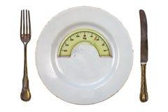 有重量平衡标度的板材 概念饮食 免版税图库摄影