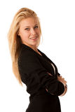 有金发和蓝眼睛的年轻女商人打手势成功的显示赞许被隔绝在白色 免版税库存照片