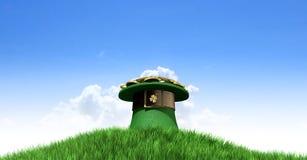 有金子的妖精帽子在草山 图库摄影