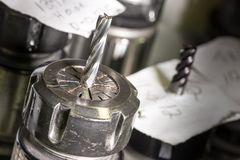 有金属钻子的CNC转动的头 库存图片