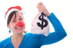 有金钱大袋的圣诞老人女孩 免版税库存图片