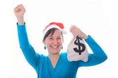 有金钱大袋的圣诞老人女孩 库存图片