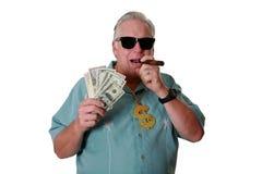 有金钱的一个人 一个人赢取金钱 一个人有金钱 一个人嗅金钱 一个人爱金钱 一个人和他的金钱 一个人是富有的 A 免版税库存照片