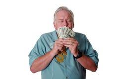 有金钱的一个人 一个人赢取金钱 一个人有金钱 一个人嗅金钱 一个人爱金钱 一个人和他的金钱 一个人是富有的 A 库存照片