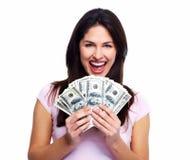 有金钱的愉快的少妇。 免版税库存图片