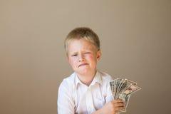 有金钱的(美元)孩子 图库摄影