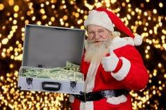 有金钱盒的快乐的圣诞老人  库存图片