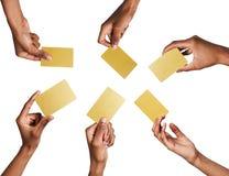 有金黄名片的黑男性手 集合,隔绝在白色 免版税库存照片