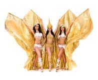 有金黄翼的三位肚皮舞表演者 免版税库存照片