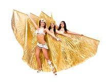 有金黄翼的三位肚皮舞表演者 库存照片