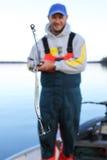 有钓鱼竿和诱剂的人 免版税库存照片