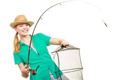 有钓鱼竿的,转动的设备妇女 库存照片